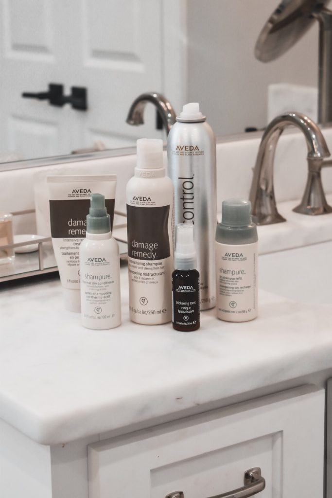 picture of Aveda products: damage remedy intensive mask, damage remedy restructuring shampoo, air control hair spray, sham pure dry shampoo, sham pure dry conditioner, thickening tonic